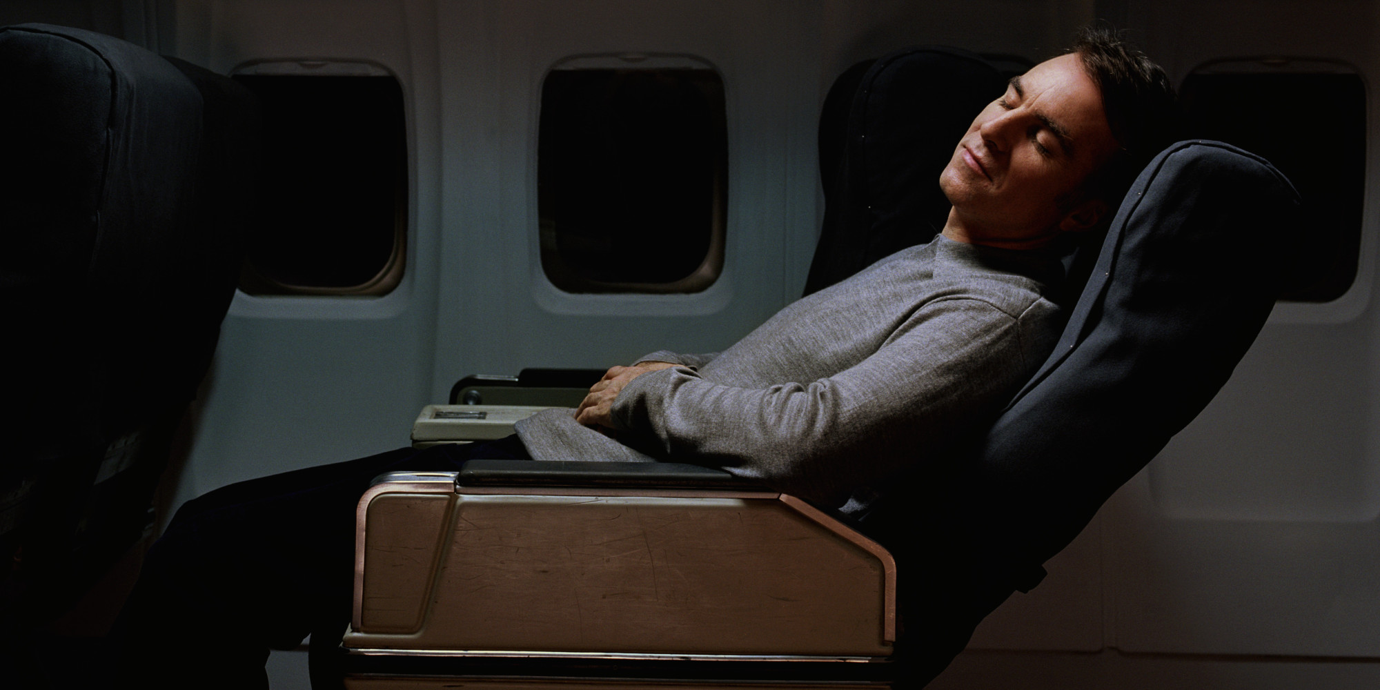 man sleeping on plane